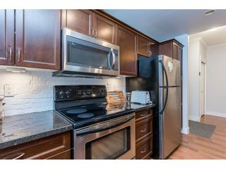 """Photo 11: 109 33338 MAYFAIR Avenue in Abbotsford: Central Abbotsford Condo for sale in """"The Sterling"""" : MLS®# R2558844"""