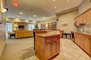 Photo 28: 1302 92 Crystal Shores Road: Okotoks Apartment for sale : MLS®# A1132113