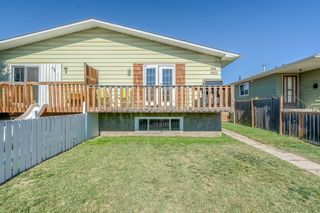 Main Photo: 108 Dovertree Place SE in Calgary: Dover Semi Detached for sale : MLS®# A1146771