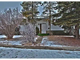 Photo 1: 11159 BRAESIDE Drive SW in Calgary: Braeside_Braesde Est House for sale : MLS®# C3653230