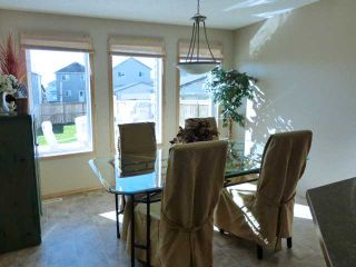 Photo 5: 183 COVECREEK Place NE in Calgary: Coventry Hills Residential Detached Single Family for sale : MLS®# C3638239