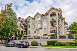 """Photo 1: 411 20281 53A Avenue in Langley: Langley City Condo for sale in """"Gibbons Layne"""" : MLS®# R2621680"""