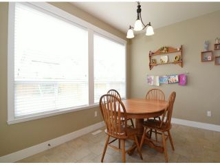 "Photo 7: 7038 195TH Street in Surrey: Clayton House for sale in ""Clayton Village"" (Cloverdale)  : MLS®# F1412928"