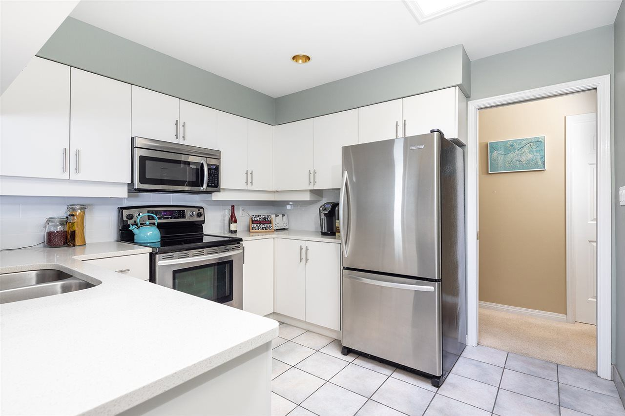 """Main Photo: 5904 NANCY GREENE Way in North Vancouver: Grouse Woods Townhouse for sale in """"Grousemont Estates"""" : MLS®# R2498380"""