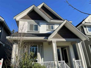 Photo 1: 5968 131 Street in Surrey: Panorama Ridge House for sale : MLS®# R2526365