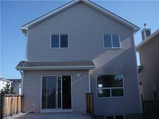 Photo 9: 129 COUGAR PLATEAU Mews SW in CALGARY: Cougar Ridge Residential Detached Single Family for sale (Calgary)  : MLS®# C3531581