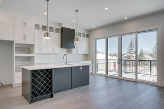 Photo 7: 154 69 Street SW in Calgary: Strathcona Park Residential for sale : MLS®# A1054727