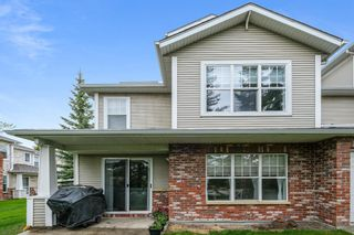 Main Photo: 2102 7171 Coach Hill Road SW in Calgary: Coach Hill Row/Townhouse for sale : MLS®# A1112790