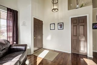 Photo 2: 188 ARBOUR STONE Close NW in Calgary: Arbour Lake House for sale : MLS®# C4139382