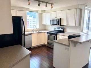 Main Photo: 504 683 10 Street SW in Calgary: Downtown West End Apartment for sale : MLS®# A1133225