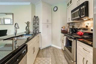 """Photo 6: 302 311 LAVAL Square in Coquitlam: Maillardville Townhouse for sale in """"HERITAGE ON THE SQUARE"""" : MLS®# R2097226"""