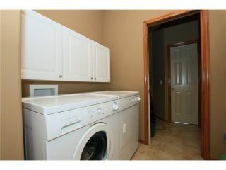 Photo 14: 18 WEST POINTE Manor: Cochrane House for sale : MLS®# C4072318