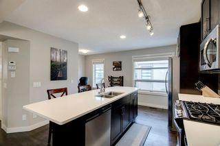 Photo 8: 35 ASPEN HILLS Green SW in Calgary: Aspen Woods Row/Townhouse for sale : MLS®# A1033284