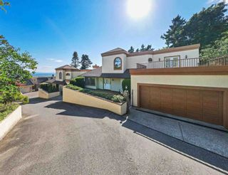 """Photo 1: 1311 133A Street in Surrey: Crescent Bch Ocean Pk. House for sale in """"Seacliffe Manor"""" (South Surrey White Rock)  : MLS®# R2605149"""