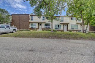 Photo 2: 71 5625 Silverdale Drive NW in Calgary: Silver Springs Row/Townhouse for sale : MLS®# A1142197