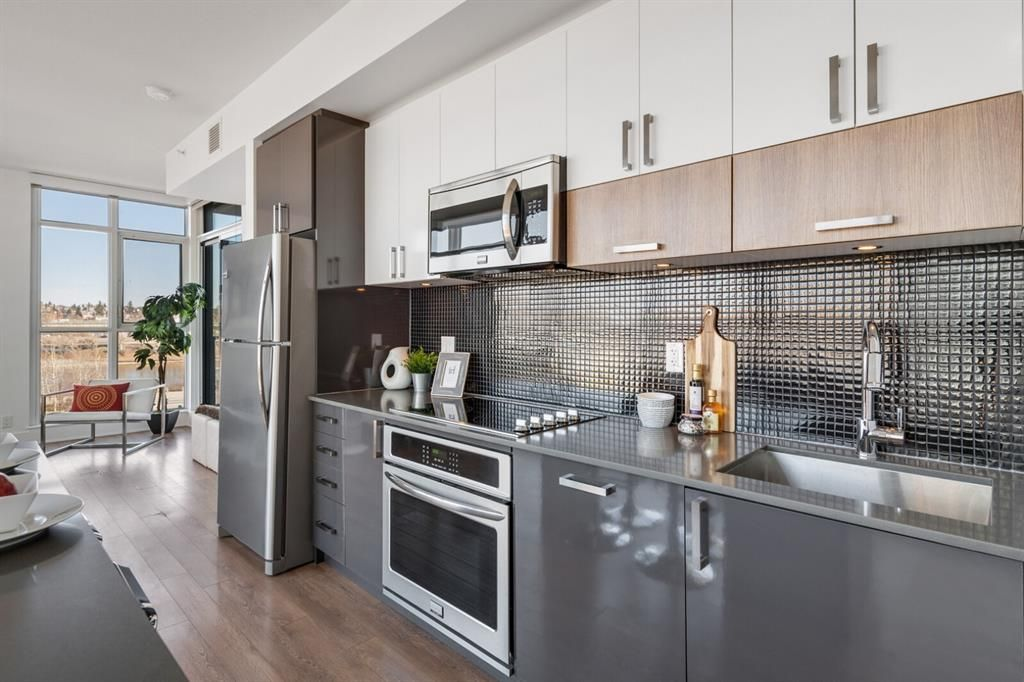 Modern Design and upgraded appliances! Now with 6 months of free condo fees and a $5000 flooring credit!