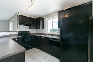 Photo 2: 8329 304 MACKENZIE Way SW: Airdrie Apartment for sale : MLS®# A1128736