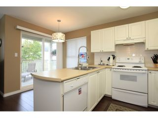 """Photo 7: 18650 65TH Avenue in SURREY: Cloverdale BC Townhouse for sale in """"RIDGEWAY"""" (Cloverdale)  : MLS®# F1215322"""