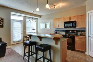 Photo 4: 132 ROCKYSPRING Grove NW in Calgary: Rocky Ridge Ranch Townhouse for sale : MLS®# C3640218