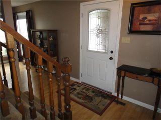 Photo 3: 351 WOODFIELD Road SW in Calgary: Woodbine House for sale : MLS®# C4050173