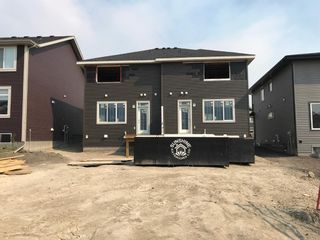 Photo 3: 23 Sunrise Heights: Cochrane Duplex for sale : MLS®# A1017998