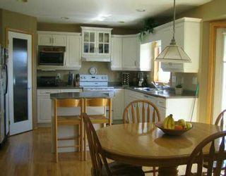 Photo 3: 62 MARKSBRIDGE Drive in Winnipeg: River Heights / Tuxedo / Linden Woods Single Family Detached for sale (South Winnipeg)  : MLS®# 2607411