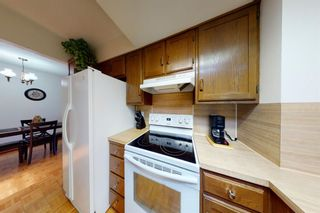 Photo 4: 601 5660 23 Avenue NE in Calgary: Pineridge Row/Townhouse for sale : MLS®# A1134714