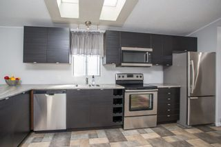 """Photo 1: 125 145 KING EDWARD Street in Coquitlam: Maillardville Manufactured Home for sale in """"MILL CREEK VILLAGE"""" : MLS®# R2493736"""