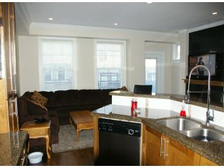 """Photo 5: 21139 80TH Avenue in Langley: Willoughby Heights Townhouse for sale in """"YORKVILLE"""" : MLS®# F1401445"""