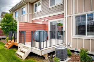 Photo 26: 15 West Coach Manor SW in Calgary: West Springs Row/Townhouse for sale : MLS®# A1100327