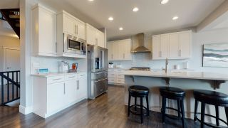 Photo 7: 8128 GOURLAY Place in Edmonton: Zone 58 House for sale : MLS®# E4240261