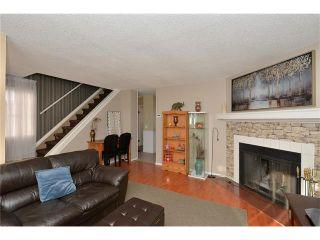 Photo 8: 10 GLENPATRICK Crescent: Cochrane House for sale : MLS®# C4094257