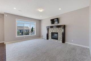 Photo 10: 144 Heritage Boulevard: Cochrane Detached for sale : MLS®# A1125296