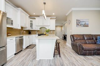 """Photo 11: 7793 211B Street in Langley: Willoughby Heights Condo for sale in """"SHAUGHNESSY MEWS"""" : MLS®# R2569575"""