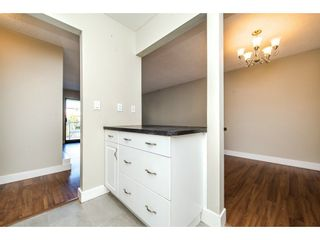 "Photo 4: 211 32870 GEORGE FERGUSON Way in Abbotsford: Central Abbotsford Condo for sale in ""Abbotsford Place"" : MLS®# R2212123"