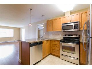 """Photo 4: 306 2373 ATKINS Avenue in Port Coquitlam: Central Pt Coquitlam Condo for sale in """"CARMANDY"""" : MLS®# V1069079"""