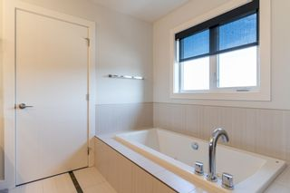 Photo 36: 3907 GINSBURG Crescent in Edmonton: Zone 58 House for sale : MLS®# E4257275