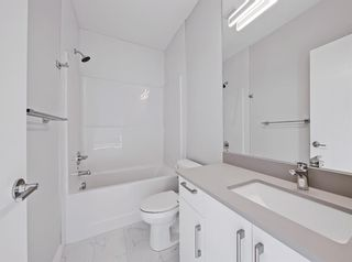 Photo 13: 2806 Edmonton Trail NE in Calgary: Winston Heights/Mountview Row/Townhouse for sale : MLS®# A1089576