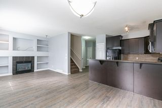 Photo 5: 58 Arbours Circle NW: Langdon Row/Townhouse for sale : MLS®# A1137898