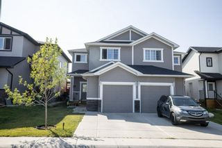 Photo 1: 67 Baysprings Way SW: Airdrie Semi Detached for sale : MLS®# A1131608