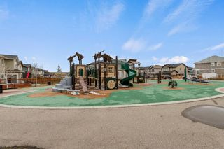 Photo 5: 1020 Brightoncrest Green SE in Calgary: New Brighton Detached for sale : MLS®# A1097905