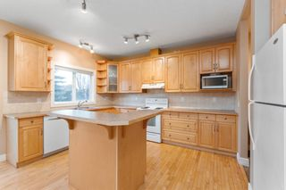 Photo 8: 7 39 Strathlea Common SW in Calgary: Strathcona Park Semi Detached for sale : MLS®# A1056254
