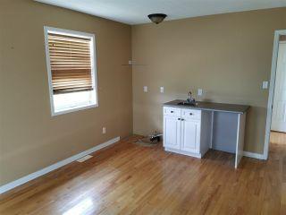 """Photo 2: 8716 117 Avenue in Fort St. John: Fort St. John - City NE House for sale in """"HUNTER TRAPP"""" (Fort St. John (Zone 60))  : MLS®# R2474026"""