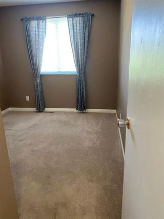 Photo 25: 554 STRATHCONA Drive SW in Calgary: Strathcona Park Semi Detached for sale : MLS®# A1020759