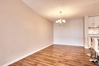 Photo 15: 509 55 ARBOUR GROVE Close NW in Calgary: Arbour Lake Apartment for sale : MLS®# A1096357