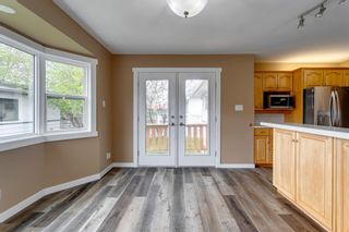 Photo 12: 2408 39 Street SE in Calgary: Forest Lawn Detached for sale : MLS®# A1114671