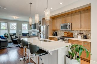 Photo 7: 460 Quarry Park Boulevard SE in Calgary: Douglasdale/Glen Row/Townhouse for sale : MLS®# A1145705