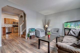 Photo 1: 704 43 Street SE in Calgary: Forest Heights Semi Detached for sale : MLS®# A1096355