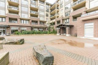 """Photo 2: 220 1211 VILLAGE GREEN Way in Squamish: Downtown SQ Condo for sale in """"Rockcliffe"""" : MLS®# R2043365"""