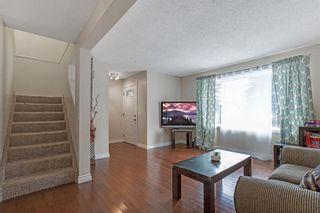 Photo 9: 21 Erin Ridge Road SE in Calgary: Erin Woods Detached for sale : MLS®# A1052761